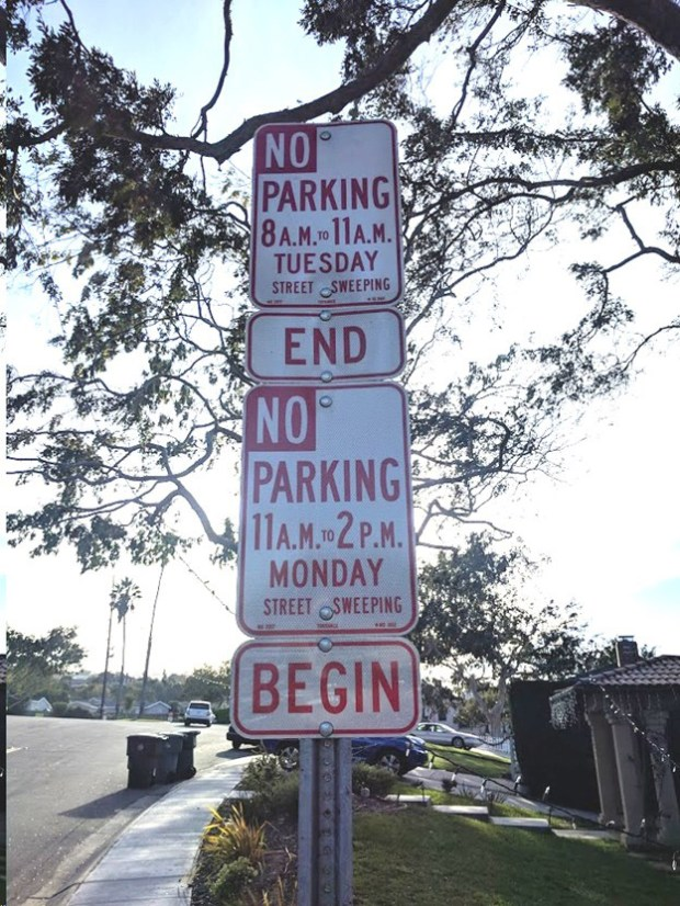 """Critics of Torrance's street cleaning program object to this kind of """"sign pollution"""" used to alert drivers to parking restrictions. This sign is on Robert Road near Doris Way in the Seaside Ranchos neighborhood. Credit: Courtesy No Signs, No Fines"""