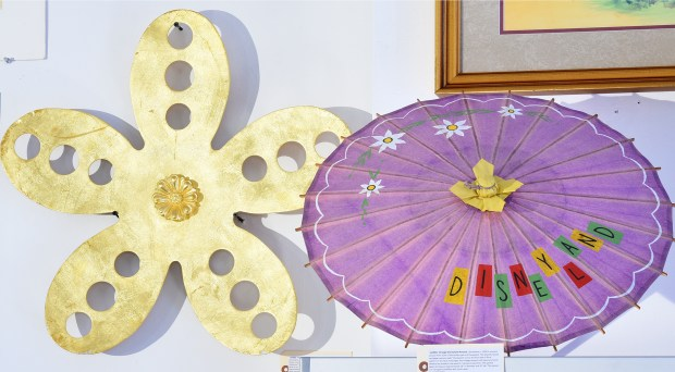 It's a Small World memorabilia, left, and this pretty 1956 parasol ($300-500) which will be auctioned Sat., Dec. 16 at Sherman Oaks' Van Eaton Galleries. Photographed on Thurs., Dec. 7. (Photo by Cindy Yamanaka, Orange County Register/SCNG)