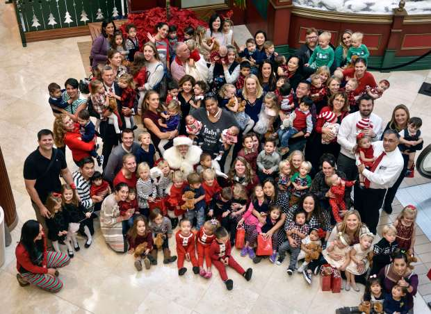 Members of the Saddleback Mother's of Multiples Club pose for a picture with Santa at South Coast Plaza in Costa Mesa, California, on Friday, December 8, 2017. (Photo by Jeff Gritchen, Orange County Register/SCNG)