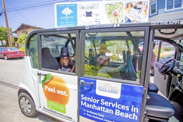 After 10 months of six-person electric vehicles with open sides scooting around downtown Manhattan Beach, the service known as the Downtowner will end in January. File Photo