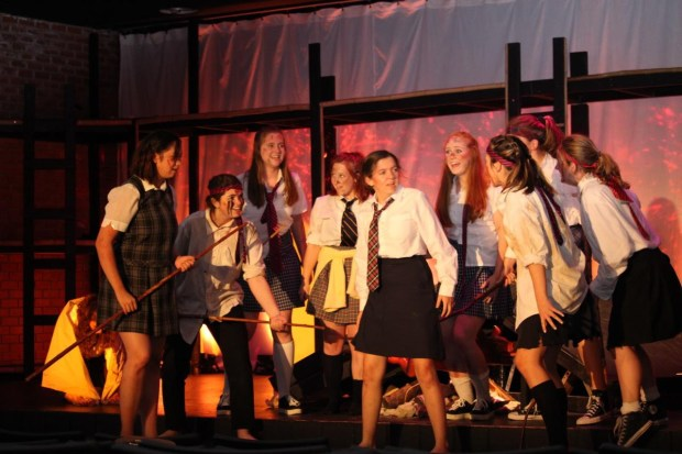 """From left, Natalie Zanzonico, Jill Greene, Sophie Matossian, Avery Saylor, Carlie McCleary, Emma Dawson, Karina Repaire, Abbi Guttierez and Lainey Reyland appear in San Clemente High School's production of """"Lord of the Flies."""" (Photo by Paola Soldan)"""