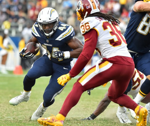 Chargers RB Andre Williams meets Redskins safety DJ Swearinger. Washington Redskins vs. Los Angeles Chargers at StubHub Center, Carson CA on Sunday December 10, 2017.Photo By Robert Casillas,Daily Breeze/ SCNG