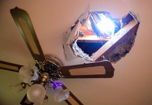 A block of ice fell out of the sky and through the roof 82-year-old Claudell Curry's home Sunday, leaving damage to his bedroom at his home in San Bernardino, Calif. on Monday, Dec. 11, 2017. Curry and his wife were not in the room at the time the ice fell through the roof of his home around 9:30 p.m. Sunday evening. (Photo by Rachel Luna, The Sun/SCNG)
