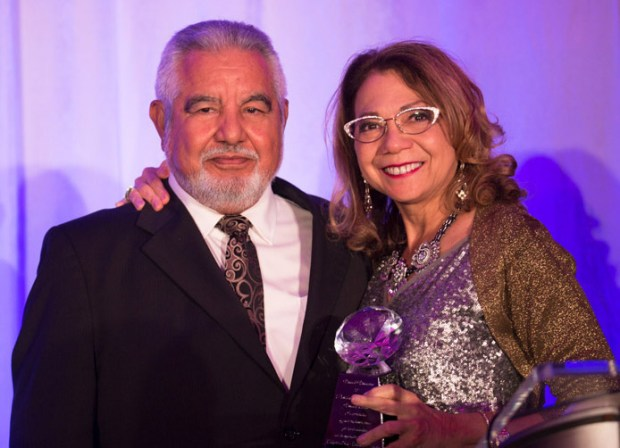 CSU Trustee Silas Abrego congratulates Cal State Fullerton President Mildred García during the recent Vision & Visionaries gala. (Photo courtesy of Cal State Fullerton)