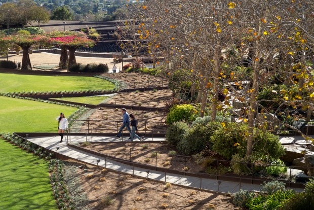 Visitors stroll through the central garden at the Getty Center in Los Angeles created by Robert Irwin. The Getty Center celebrates its 20th anniversary this month. (Photo by David Crane, Los Angeles Daily News/SCNG)