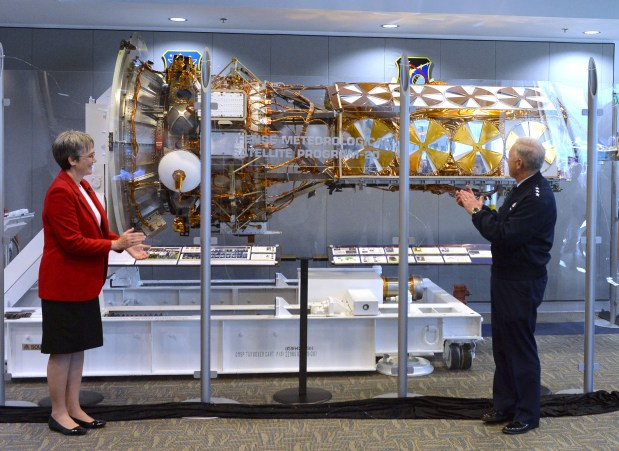 Secretary of the Air Force Heather Wilson, left, and Lt. Gen. John F. Thompson applaud during unveiling of Defense Meteorological Support Program Satellite Thursday December 14, 2017 at Los Angeles AFB in El Segundo. Photo by Robert Casillas, Daily Breeze/SCNG