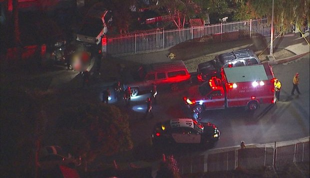 Police officers and firefighters are on scene Friday, Dec. 15, 2017, on the 13000 block of Jouett Street in Pacoima where five people, including a 10-year-old girl, were shot. (Image from ABC7's helicopter)