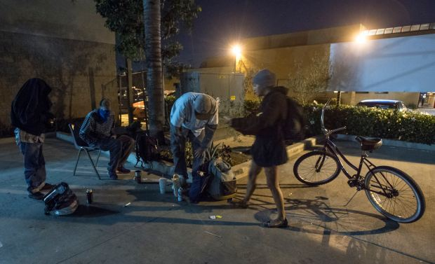 Groups of homeless people, including rehab dropouts, hang together in Costa Mesa on Tuesday, Dec 12, 2017.(Photo by Mindy Schauer, Orange County Register/SCNG)