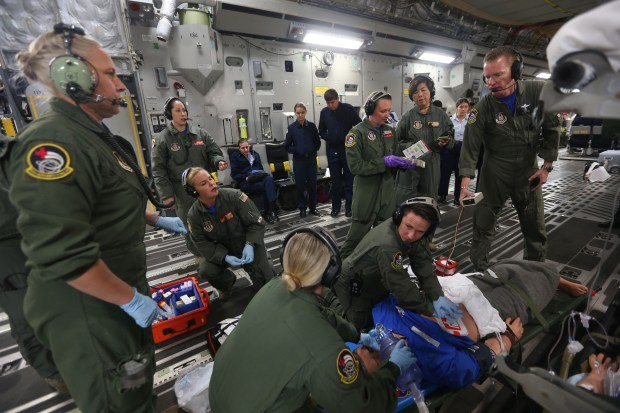 A crew with the Air Force ReserveÕs 452nd Air Mobility Wing C-17 practice an aeromedical evacuation proficiency training mission as cadets from Canyon Springs High School Junior ROTC program while flying in the C-17 on Monday, Dec. 19, 2017.(Stan Lim, The Press-Enterprise/SCNG)
