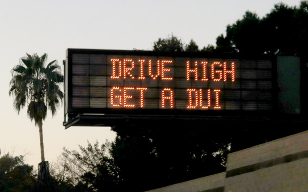 A lighted sign on the 405 Freeway in the San Fernando Valley warns drivers about smoking marijuana while operating a motor vehicle, as seen Wednesday, Dec. 27, 2017. (Photo by Dean Musgrove, Los Angeles Daily News/SCNG)