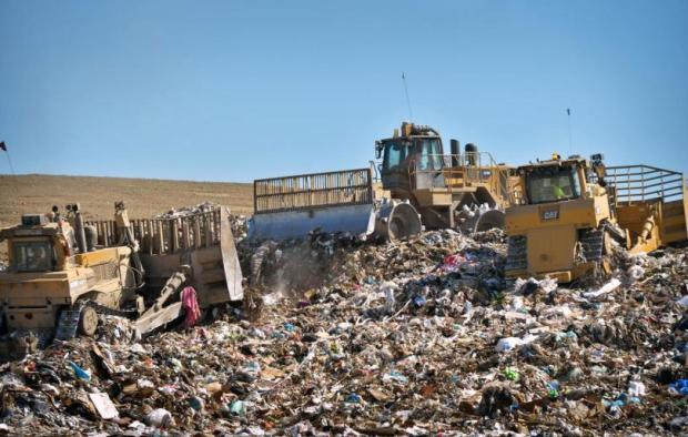 Tractors are used to spread out and layer incoming trash to the desired area at the Olinda Landfill in 2015.(PHOTO: STEVEN GEORGES, CONTRIBUTING PHOTOGRAPHER)