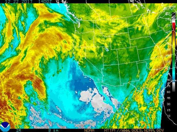 The enhanced infrared satellite image of the Western US for Friday, Dec. 22, 2017, shows considerable storm activity in the Pacific Ocean, and some in the Pacific Northwest and Northern California. But Southern California is dry and cold. Temperatures are expected to rise about 12 degrees on Saturday. (Image courtesy of the National Weather Service)