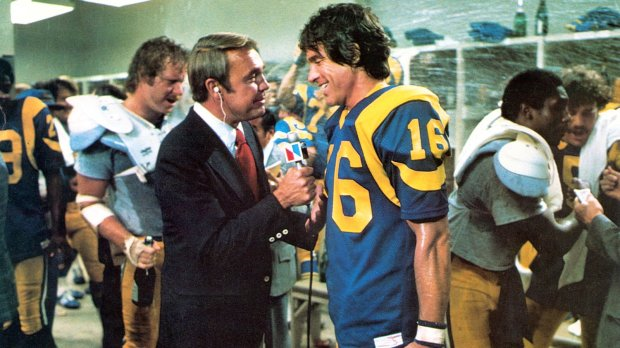 "From the 1978 movie ""Heaven Can Wait,"" with Dick Enberg, left, and Warren Beatty. (Paramount Pictures)"