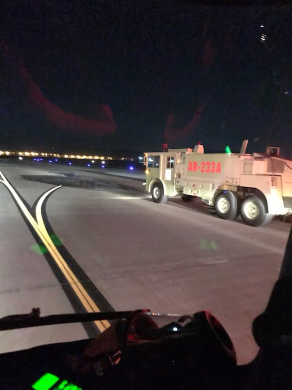 A San Bernardino County Fire District photo shows one of the rigs positioned at San Bernardino International Airport on Friday night after the pilot of a small plane reported landing gear trouble and prepared to land.