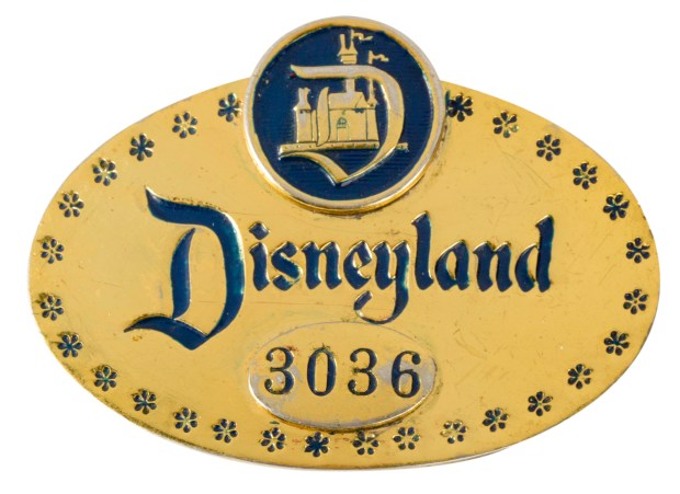 "Early Disneyland cast member badge, circa 1955-1962. An extremely rare original Disneyland metal ID badge in the style used in the park between 1955 and 1962. Before the well-known Disneyland cast member name tags were issued, Disneyland supplied these stamped aluminum employee ID number badges to all cast members. Walt Disney himself carried one of these with the ID #1. This badge is number 3036 and measures 2""x2.5"". The badge is in good condition with some expected scuffing and tarnishing from use. Photo and description courtesy of Van Eaton Galleries, Sherman Oaks, CA."