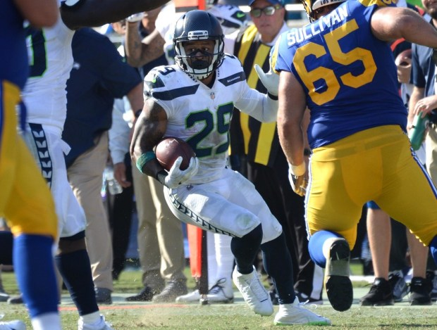 Seahawks safety Earl Thomas runs for yards after interception in the second quarter against the Rams on Oct. 8. (Photo by Stephen Carr / Daily Breeze / SCNG)