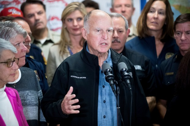 California Gov. Jerry Brown discusses the Thomas fire and the extended length of the state's fire season during a press conference on Saturday, Dec. 9, 2017, in Ventura, Calif. (AP Photo/Noah Berger)