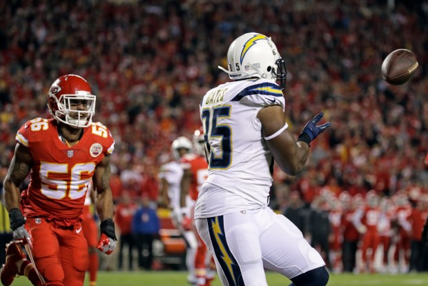Los Angeles Chargers tight end Antonio Gates (85) makes a touchdown catch in front of Kansas City Chiefs linebacker Derrick Johnson (56) during the second half of an NFL football game in Kansas City, Mo., Saturday, Dec. 16, 2017. (AP Photo/Charlie Riedel)