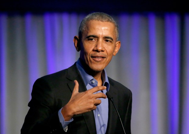Former U.S. President Barack Obama address the participants at a summit on climate change involving mayors from around the globe Tuesday, Dec. 5, 2017, in Chicago. The conference comes after President Trump said the U.S. will pull out of the Paris agreement. Tuesday, Dec. 5, 2017, in Chicago. (AP Photo/Charles Rex Arbogast)