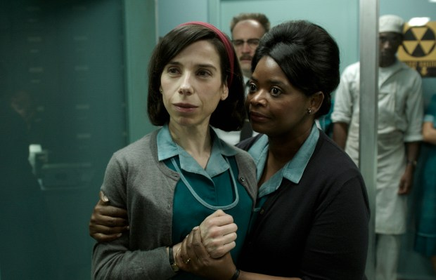 "This image released by Fox Searchlight Pictures shows Sally Hawkins, left, and Octavia Spencer in a scene from the film ""The Shape of Water."" On Monday, Dec. 11, 2017, Hawkins was nominated for a Golden Globe for best actress in a motion picture drama for her role in the film. The 75th Golden Globe Awards will be held on Sunday, Jan. 7, 2018 on NBC. (Fox Searchlight Pictures via AP)"