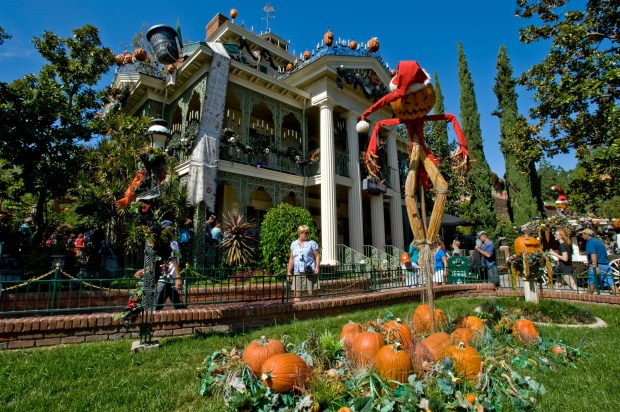 The Haunted Mansion, dressed here for the holidays, was originally conceived as a dilapidated, spooky building. (File photo by Joshua Sudock, Orange County Register/SCNG)