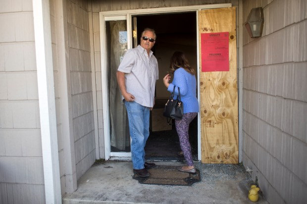 Art and Sylvia Valenzuela enter their home in the Santiago Estates to asses the damage caused by the Creek Fire in Sylmar on Monday, Dec. 11, 2017. (Photo by Hans Gutknecht, Los Angeles Daily News/SCNG)