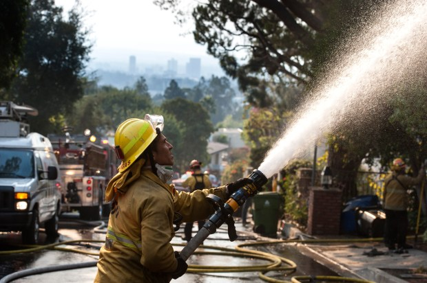 Los Angeles City firefighter Luis Vargas battles the Skirball Fire on Casiano Road in Bel-Air on Wednesday, Dec. 06, 2017. (Photo by Ed Crisostomo, Los Angeles Daily News/SCNG)