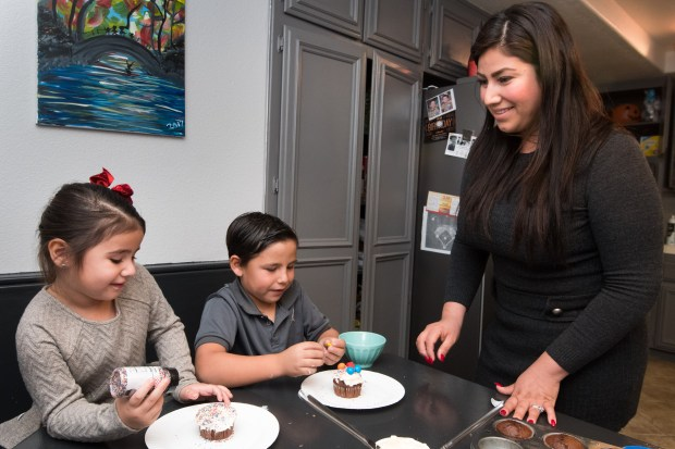 Kassandra Higuera and her brother Jay Higuera decorate cupcakes with their mother Angelica Higuera at their Yorba Linda home on Monday, December 18, 2017 in Yorba Linda, Calif. (Photo by Josh Barber, Contributing Photographer)