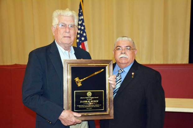 Former Perris Mayor Daryl Busch, left, accepts the Alberta Mable Kearney Citizen of the Year Award from Mayor Michael Vargas during a ceremony May 4, 2017, in Perris. (Photo courtesy of the city of Perris)