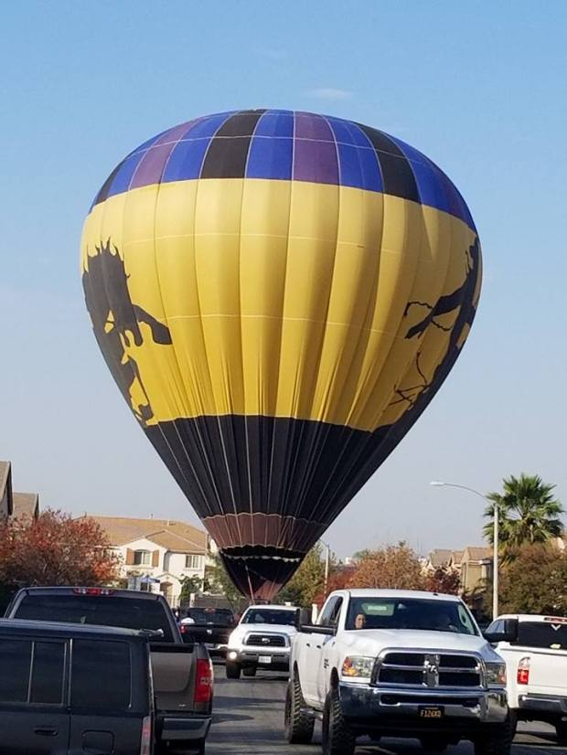 Tabatha Reece of Moreno Valley snapped a photo after the balloon landed in the middle of the street, Saturday, December 16, 2017.