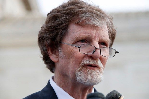 Jack Phillips speaks to the media after leaving the Supreme Court which is hearing the 'Masterpiece Cakeshop v. Colorado Civil Rights Commission,' Tuesday, Dec. 5, 2017, in Washington. (AP Photo/Jacquelyn Martin)
