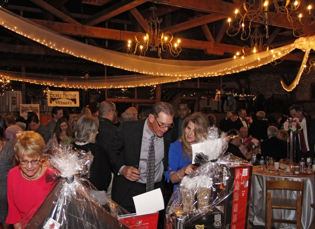 Guests peruse the silent auction items at the 2017 Chocolate Fantasy at the Mitten Building in Redlands. (Courtesy Photo)