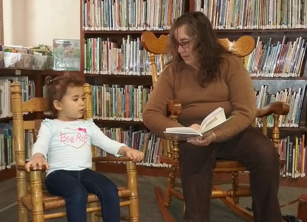 Lucila Campa, who has participated in the Redlands Adult Literacy Program, reads to Anaya Barboza, 3, at the A.K. Smiley Public Library's Spanish story time Jan. 9. (Courtesy Photo)