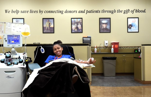 Jazz Coleman, of Fontana, donates blood for the first time, at LifeStream in San Bernardino, CA., Tuesday, January 16, 2018. The blood bank is in need of O Negative blood donations. Coleman is also on staff as a Donor Specialist at LifeStream. (Staff photo by Jennifer Cappuccio Maher/The Sun/SCNG)