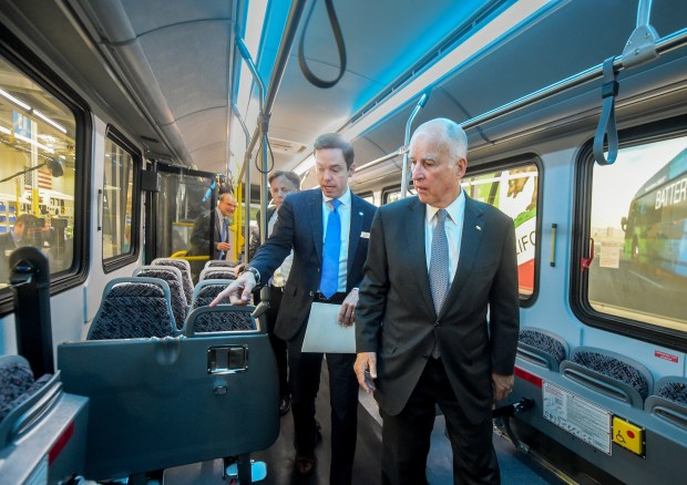 Ryan Popple, left, President, CEO of Proterra and Governor Brown walking through an electric bus by Proterra Wednesday, July 26, 2017. Governor Brown visited Proterra, the leading innovator in heavy-duty electric transportation. Proterra, the leading innovator in heavy-duty electric transportation, officially commemorated opening its new L.A. manufacturing facility. With transit agencies across the country committing to zero-emission battery electric bus fleets and Proterra leading this mass-market shift. Pro terra's facility soon to be its first customer, Foothill Transit, which serves 22 cities from downtown L.A. to east, and is currently operating 17 of Proterra's electric buses with 30 new Catalyst E2 more buses on the way.(Photo by Walt Mancini/Pasadena Star-News/SCNG)