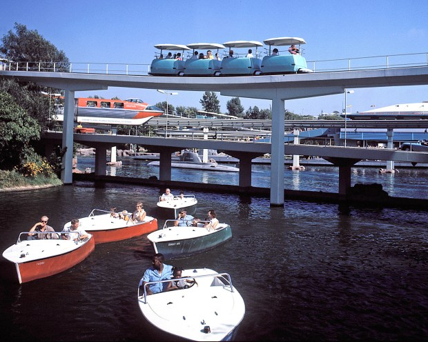 The PeopleMover, top, traverses over the Motor Boat Cruise and the Disneyland-Alweg Monorail in this historic photo. (Photo courtesy of the Disneyland Resort)