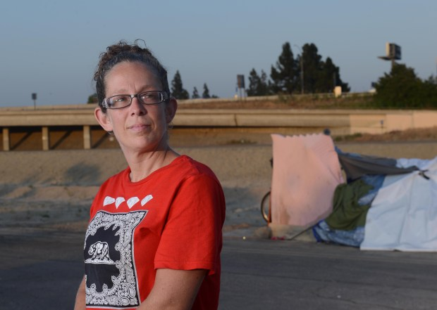 Angela Peifer is employed as a caregiver. She has lived along the riverbed for more than two years. She is close to getting into permanent housing through a county program, but in the short-term, she said she has no idea where sheÕll go once she leaves the riverbed. (Photo by Bill Alkofer,Orange County Register/SCNG)