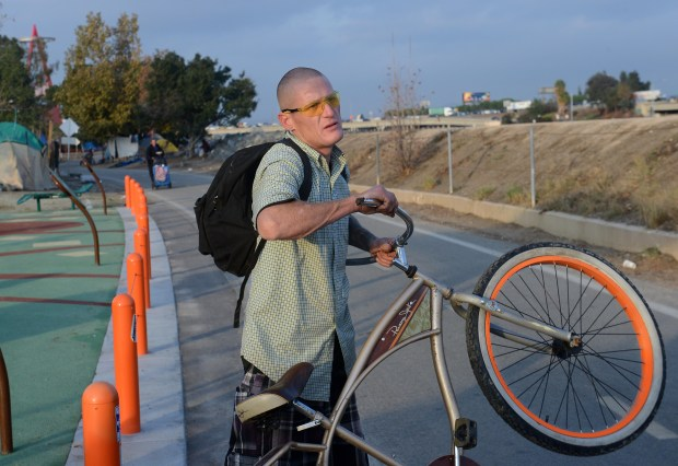 Matt Sileski is a San Clemente native who has been homeless in the riverbed for six months. He has two kids who live with his father. He said heÕs addicted to meth. When the riverbed encampment is closed, he said he might try to travel down to San Diego, but more likely he'll end up sleeping on the streets of Anaheim. (Photo by Bill Alkofer, Orange County Register/SCNG)