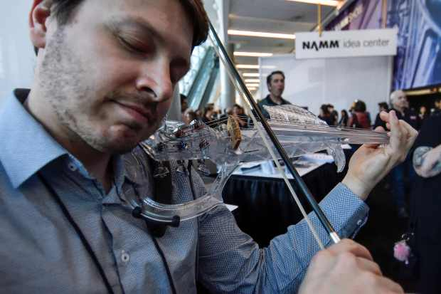 Laurent Bernadac, of 3dvarius, shows off their five-string acrylic electric violin during a media preview at NAMM in Anaheim, California, on Wednesday, January 24, 2018. (Photo by Jeff Gritchen, Orange County Register/SCNG)