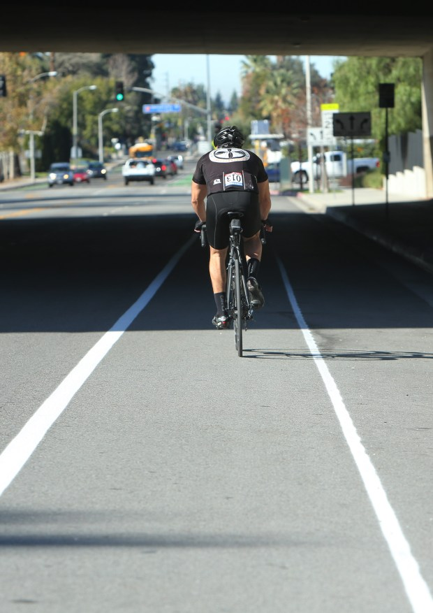 A cyclist uses the temporary bike lane that has been sprayed on Citrus Avenue from University Street to Wabash Avenue on Wednesday, Jan. 24, 2018. The city plans to paint the lanes green in the upcoming weeks. (Stan Lim, Redlands Daily Facts/SCNG)