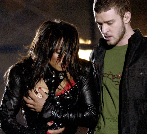 Janet Jackson, left, covers her breast after her outfit came undone during the half time performance with Justin Timberlake at Super Bowl XXXVIII between the Carolina Panthers and New England Patriots in Houston, Sunday Feb. 1, 2004. (File photo by David Phillip, the Associated Press)