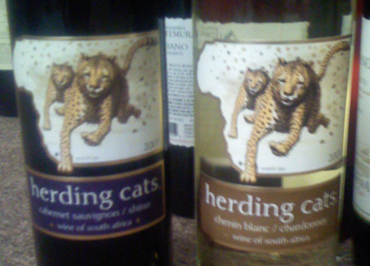 """Herding Cats: The idea behind this South African brand is that the winemakers """"herd together"""" varietals sourced from all over the country and create blends showcasing pairs of varietals. Unless you're a masochist who really loves organizing felines' prissy little lives, """"cat herding"""" is the very definition of a frustrating and useless activity. So why name a wine after it? (Photo courtesy Herding Cats Wine)"""