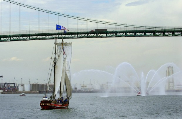 """The tallship """"Swift of Ipswich"""" sails under the Vincent Thomas Bridge as she enters the Port of Los Angeles, Friday, Sept. 6, 2002. The ship is one of more than a dozen tallships participating in the """"Festival of Sail."""" (AP Photo/Nick Ut)"""