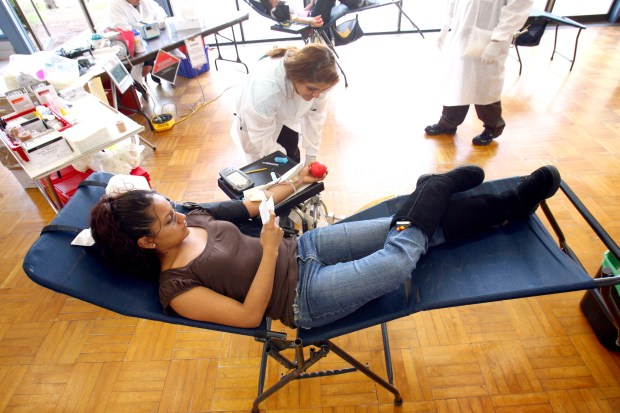 Ana Marroquin relaxes as she donates blood during the American Red Cross Blood Drive at Pierce College Wednesday March 12, 2008.(Andy Holzman/Staff Photographer)