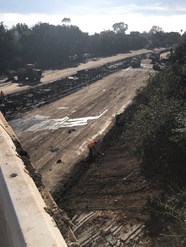 Caltrans workers continue clearing the 101 Freeway of mud and debris after mudslides blocked the highway between Carpenteria and Santa Barbara. A cold, fast-moving storm Friday, Jan. 19, 2018, could bring some rain to Southern California and snow to local mountains. (Photo courtesy of Caltrans)