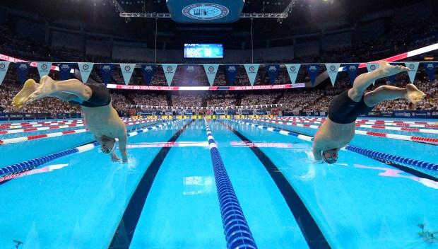 FILE - In this July 1, 2016, file photo, Michael Phelps, left, and Ryan Lochte start the men's 200-meter individual medley at the U.S. Olympic swimming trials, in Omaha, Neb. USA Swimming knew it wanted to return to Omaha for the Olympic trials in 2020, so the sport's national governing body didn't seek or accept bids from other potential host cities, interim executive director Mike Unger said Monday, May 1, 2017. Unger on Monday announced the trials would be back in Nebraska's largest city for the fourth straight time.(AP Photo/Mark J. Terrill)
