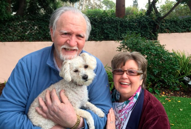 This January 2017, photo provided by Kelly Weimer, shows Jim Mitchell, 89, with his wife, Alice Mitchell, 78, and their dog, Gigi. The Mitchell's were the oldest victims of the storms when their Montecito, Calif., home was swept away by the torrent of mud, trees and boulders that flowed down a fire-scarred mountain and slammed into the coastal town in Santa Barbara County. (Kelly Weimer via AP)