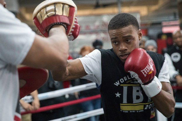 Errol Spence Jr. throws a punch while sparring with a trainer during a workout at Gleason's Gym in Brooklyn on Wednesday.  Spence is slated to defend his IBF welterweight title against Lamont Peterson on Saturday. (AP Photo/Mary Altaffer)