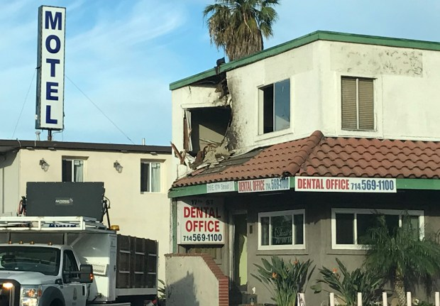 A big hole remains after the car was removed from the building. (Photo by Alma Fausto)