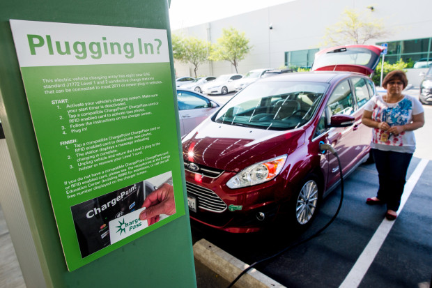 Marilyn North, of Pomona, charges her Ford C-Max Energi at the Southern California Edison Energy Education Center in Irwindale on Friday, May 13, 2016. (SCNG photo by Watchara Phomicinda/ San Gabriel Valley Tribune)